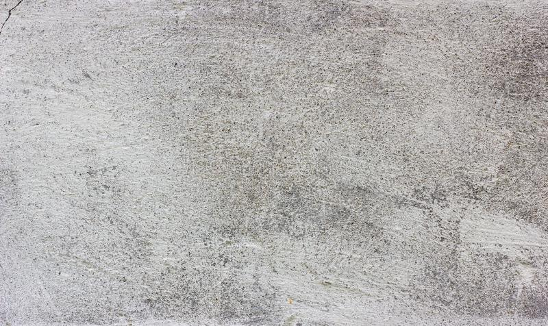 Old grunge dirty cracked vintage light gray concrete and cement mold texture wall or floor background with weathered paint. And scratches stock photography