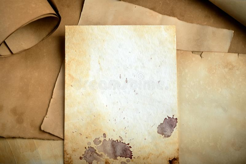 Old paper background. Old grunge paper background on torn medieval scrolls document stock photos