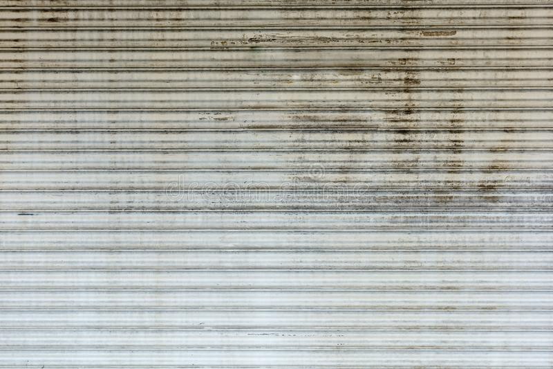 Old grunge and rusty steel rolling door background and texture. royalty free stock photos