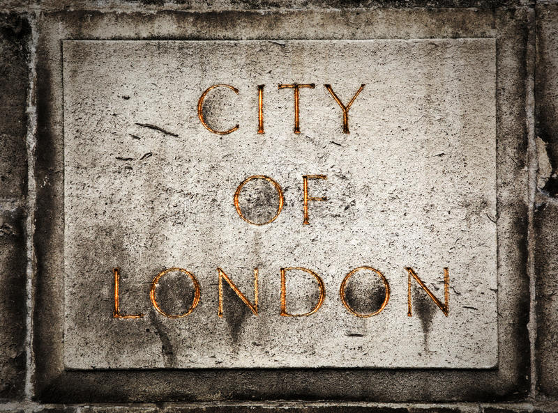 Old grunge stone board with City of London text stock photos