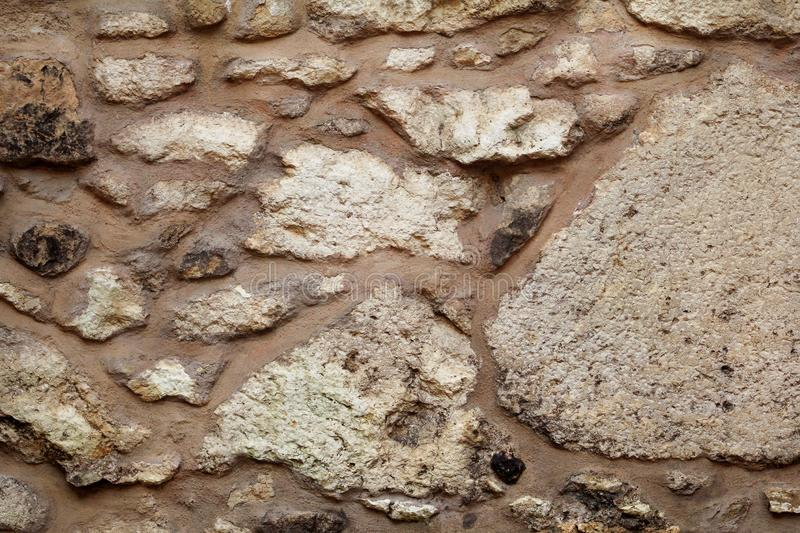 Old grunge stone wall texture, material, pattern wallpaper and background, close up. Natural contrast masonry rock wall granite. stock image