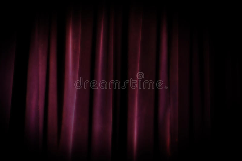 Old grunge theater purple curtain background. Dramatic background royalty free stock image