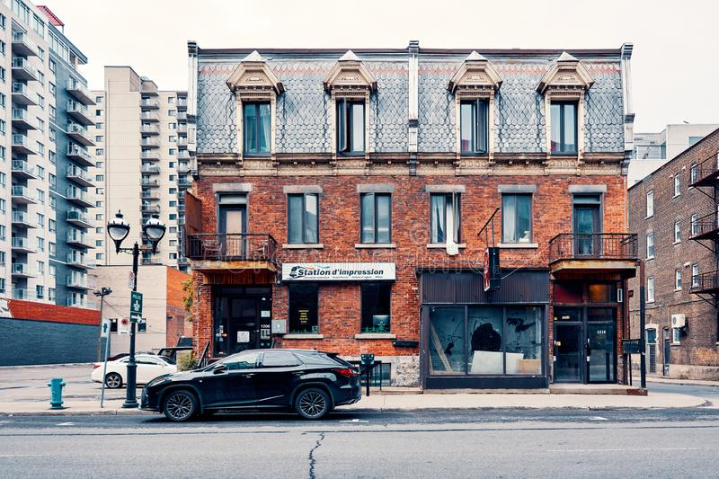 Old grunge victorian style brick building on saint denis street in Montreal royalty free stock images