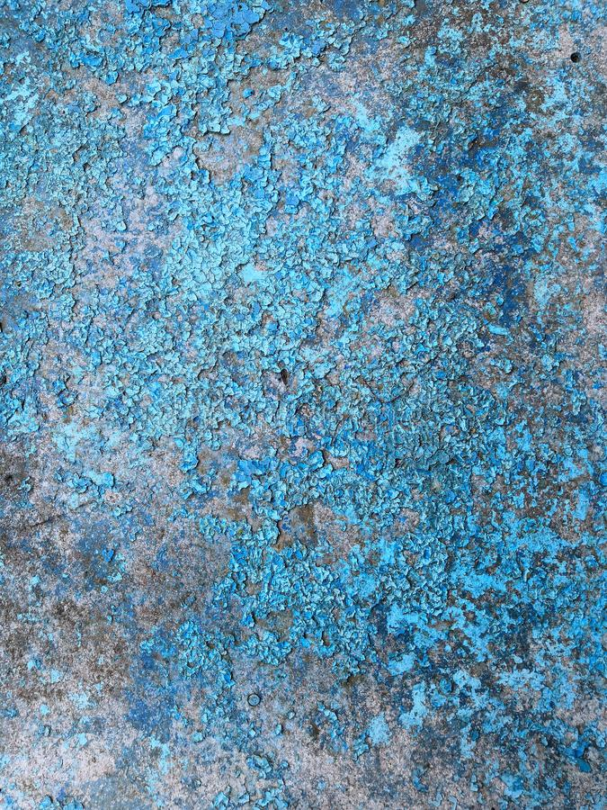 Old grunge vintage background: rusty metal surface with blue paint flaking and cracking texture stock image