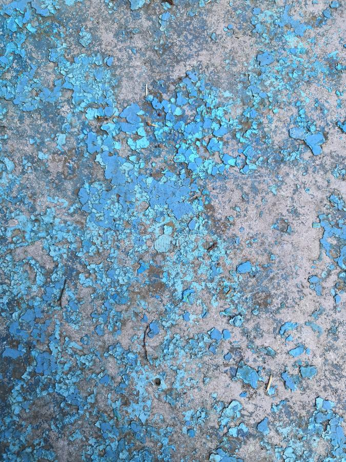 Old grunge vintage background: rusty metal surface with blue paint flaking and cracking texture royalty free stock photos