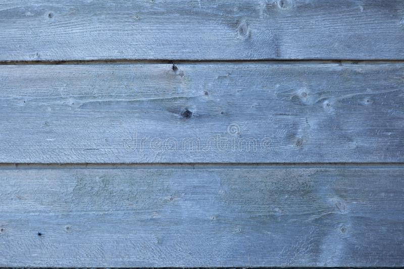 Old grunge wooden fence pattern in blue tone. Abstract background and texture for design stock photos