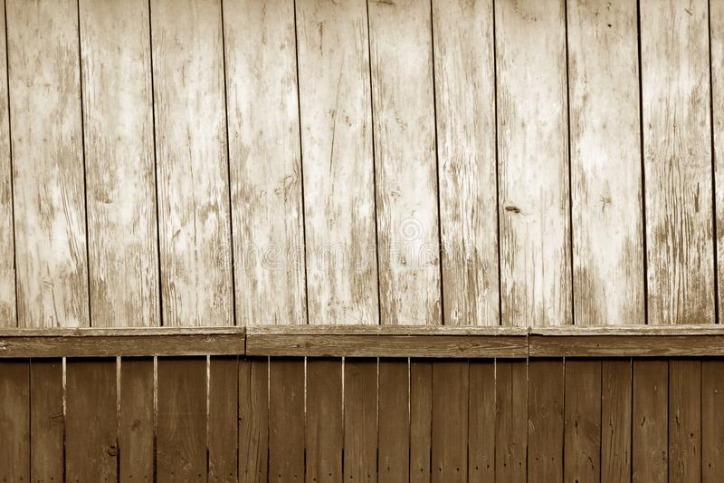 Old grunge wooden fence and wooden wall pattern in brown tone. Abstract background and texture for design, color, vintage, weathered, timber, tree, carpentry stock images