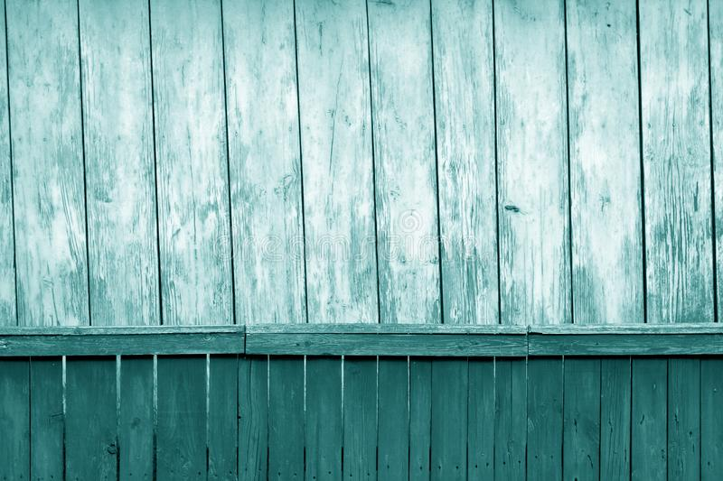 Old grunge wooden fence and wooden wall pattern in cyan tone. Abstract background and texture for design, blue, green, color, vintage, weathered, timber, tree stock image