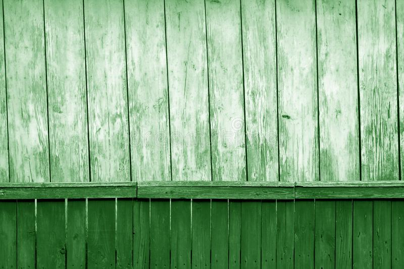 Old grunge wooden fence and wooden wall pattern in green tone. Abstract background and texture for design, color, vintage, weathered, timber, tree, carpentry royalty free stock images