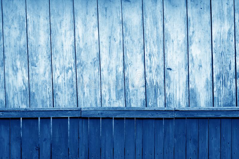 Old grunge wooden fence and wooden wall pattern in navy blue tone. Abstract background and texture for design, color, vintage, weathered, timber, tree stock photo