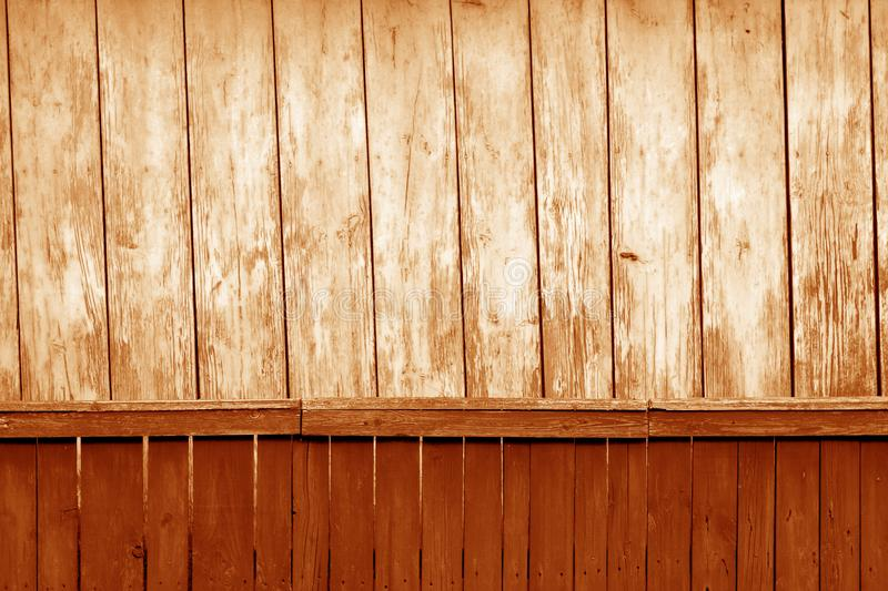 Old grunge wooden fence and wooden wall pattern in orange tone. Abstract background and texture for design, color, vintage, weathered, timber, tree, carpentry royalty free stock photos