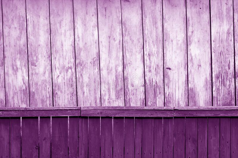 Old grunge wooden fence and wooden wall pattern in purple tone. Abstract background and texture for design, color, vintage, weathered, timber, tree, carpentry stock photos