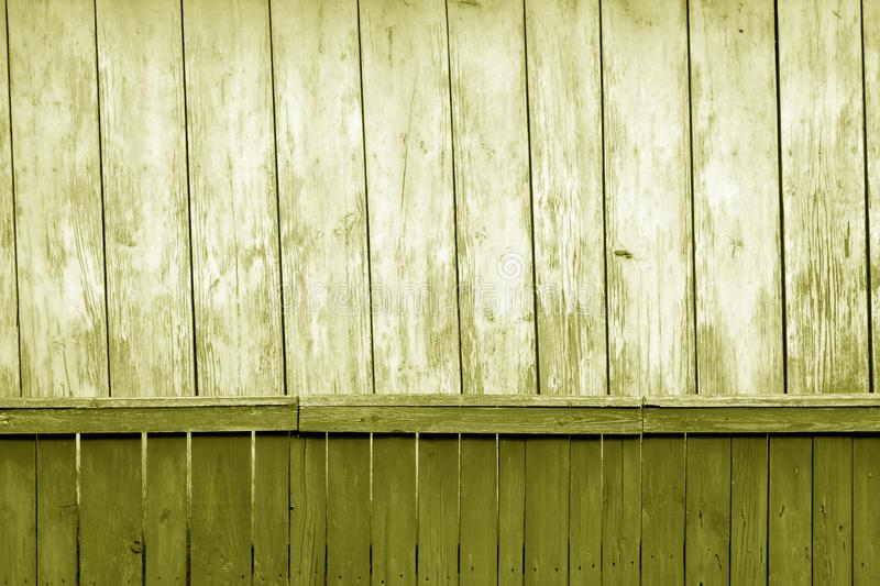 Old grunge wooden fence and wooden wall pattern in yellow tone. Abstract background and texture for design, color, vintage, weathered, timber, tree, carpentry stock images