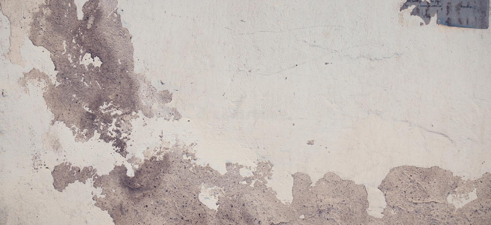 Old grungy brick and stone wall with damaged plaster banner background texture. royalty free stock images