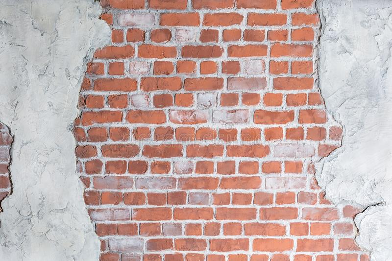 Old grungy brick wall with concrete stucco royalty free stock images