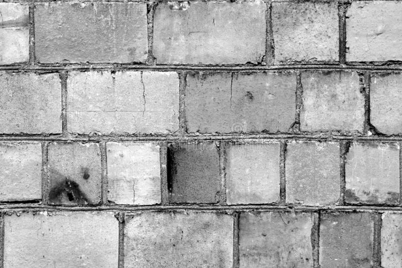 Old grungy brick wall surface in black and white royalty free stock images