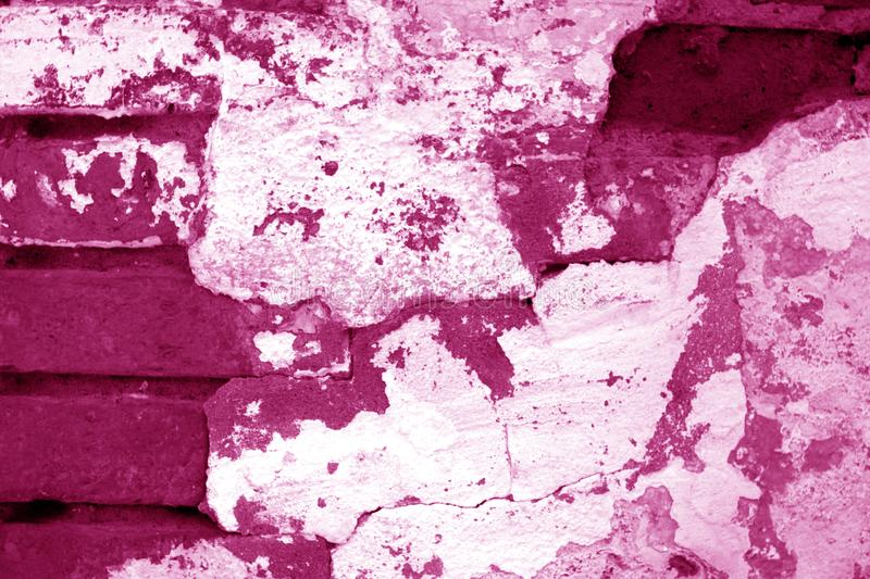 Old grungy brick wall texture in pink tone stock photo