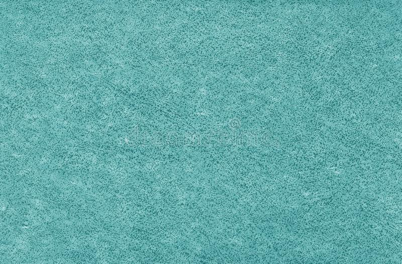 Old grungy canvas pattern with dirty spots in cyan color royalty free stock photography