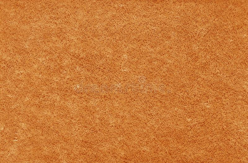 Old grungy canvas pattern with dirty spots in orange color royalty free stock photos
