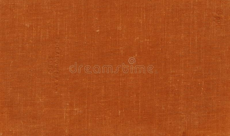 Old grungy canvas pattern with dirty spots in orange color stock images