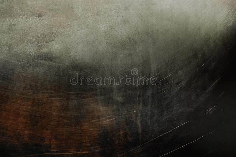 Old grungy metallic wall background or texture. Detail of old dark scratched wall abstract background stock image
