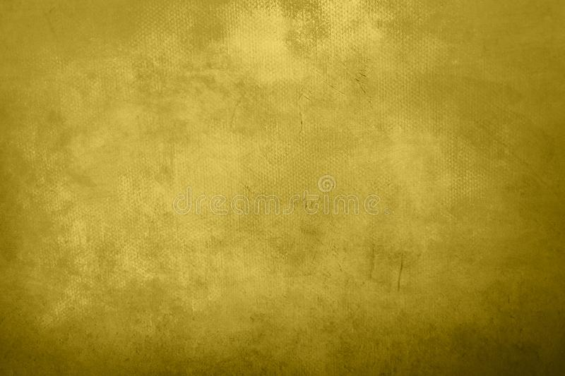 Old grungy painting background. Abstract yellow golden canvas detail texture or background royalty free stock images