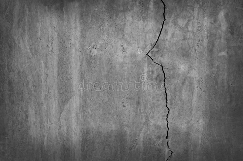 Old grungy texture with dark grey, cracked and dirty concrete or cement wall for background and design art work stock image