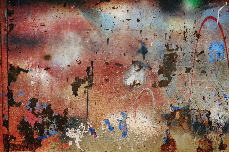 Old grungy wall. Old colorful grungy wall background or texture stock image
