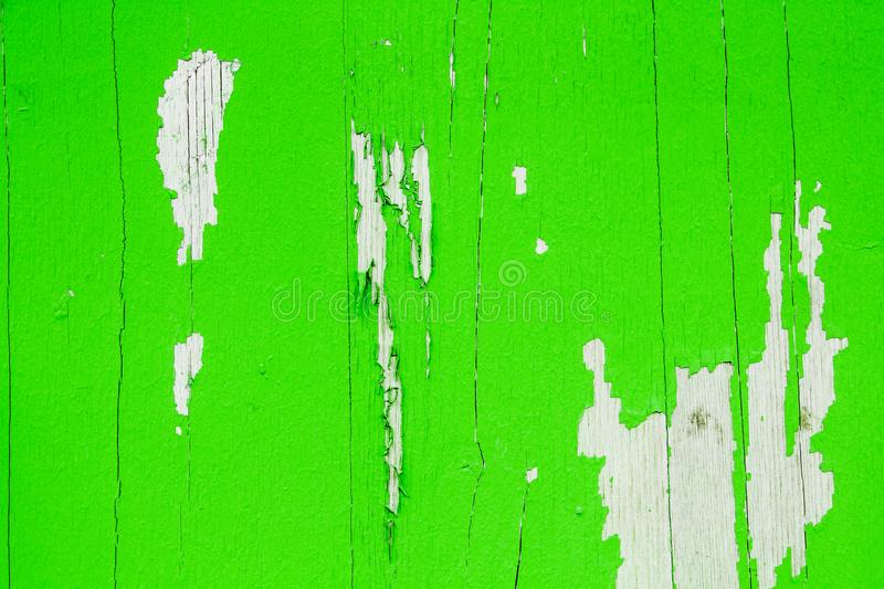 Old grungy and weathered green painted wooden wall plank texture background peeling off stock photography