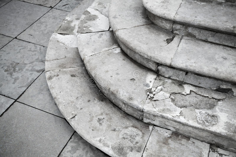 Old grungy white ancient stone stairway stock photo