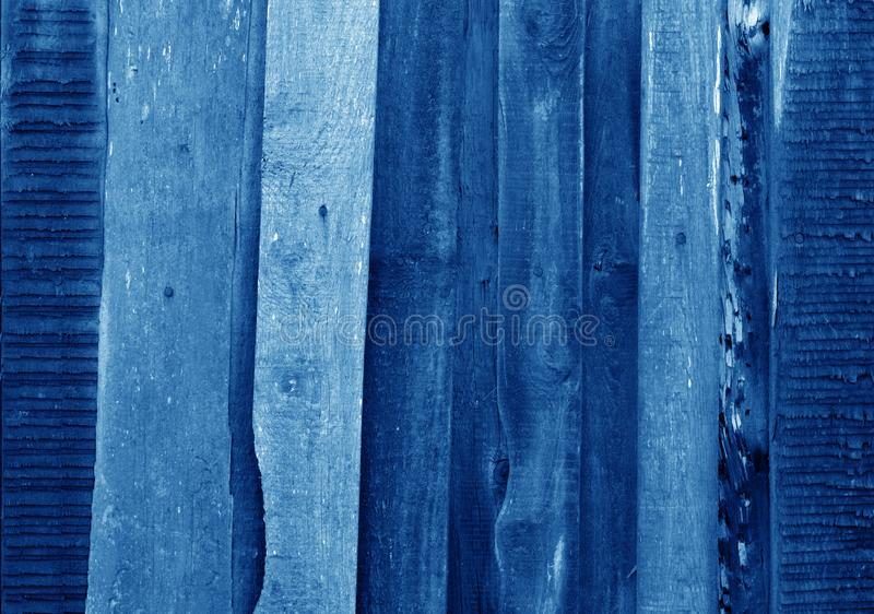 Old grungy wooden planks background in navy blue tone. Abstract background and texture for design, color, vintage, weathered, timber, wall, tree, carpentry stock image