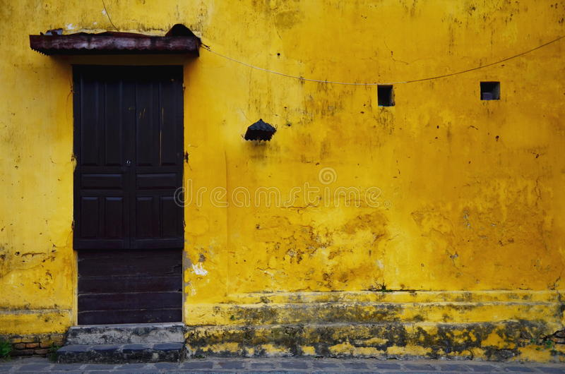 Old and grungy yellow wall royalty free stock image