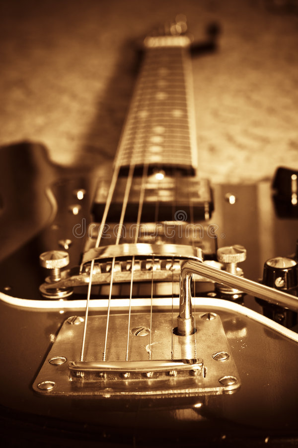 Old guitar. Sepia tone vintage electric guitar royalty free stock photography