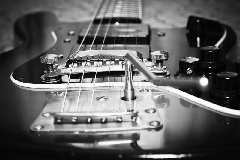 Old guitar. An old guitar in black-and-white colors. Shot with vignette effect stock photography
