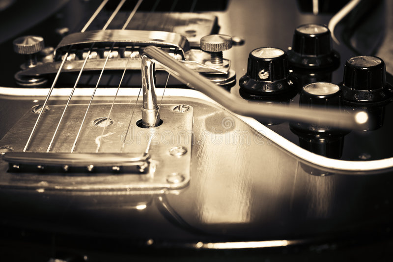 Old guitar. Vintage electric wooden sepia color guitar royalty free stock photography
