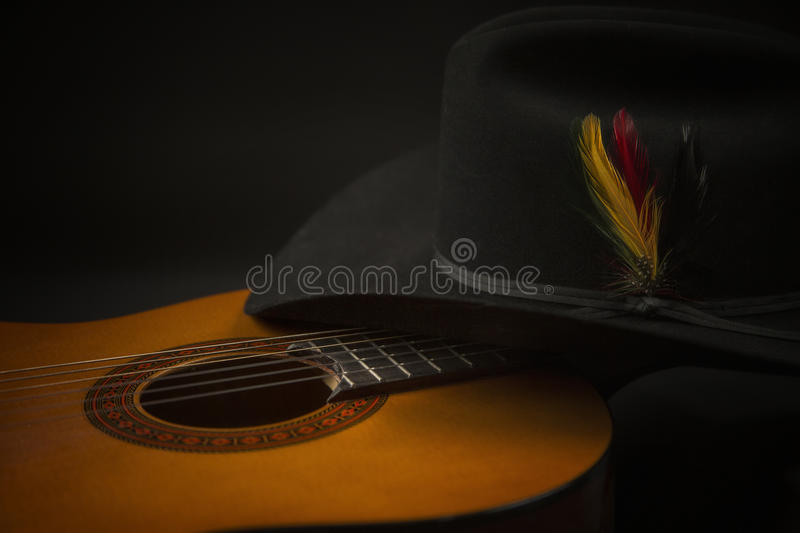 Old Guitar with a Western Hat royalty free stock photos