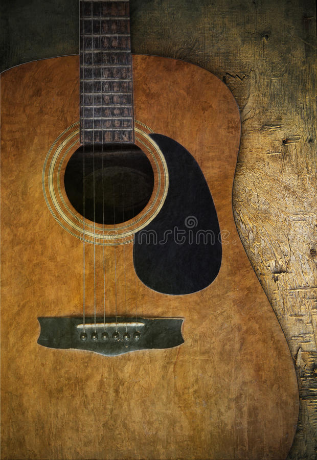 Old guitar on wood textured stock image