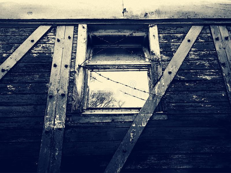 Old Gulag wagon. With barbed wire window royalty free stock images