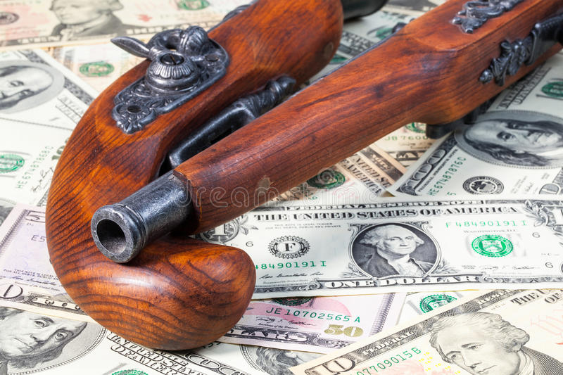 Old Guns And Money And Money Royalty Free Stock Image
