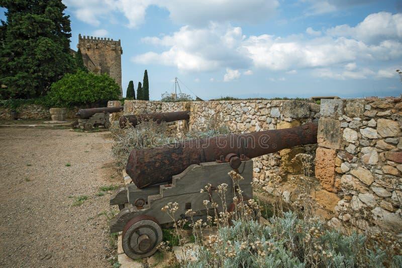 Old guns in Tarragoa Passeig arqueologic Archaeological Promenade. Old guns in Tarragona Passeig arqueologic Archaeological Promenade under Roman era walls royalty free stock images