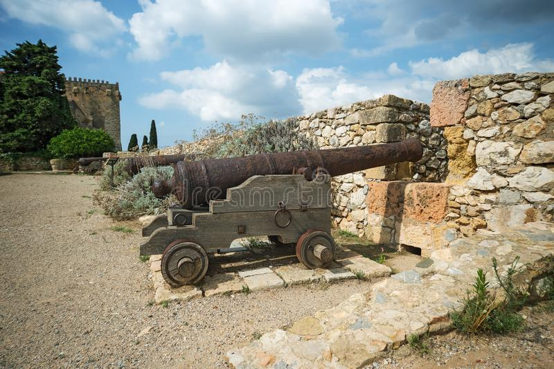 Old guns in Tarragona Passeig arqueologic under Roman era walls. Old guns in Tarragona Passeig arqueologic Archaeological Promenade under Roman era walls royalty free stock photos