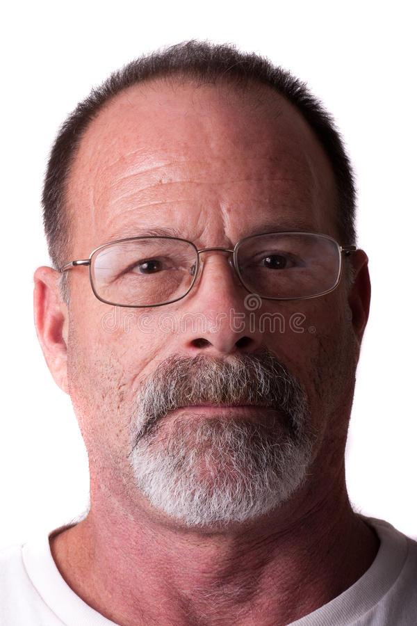 Old Guy in Grey Beard and Glasses Serious royalty free stock photo