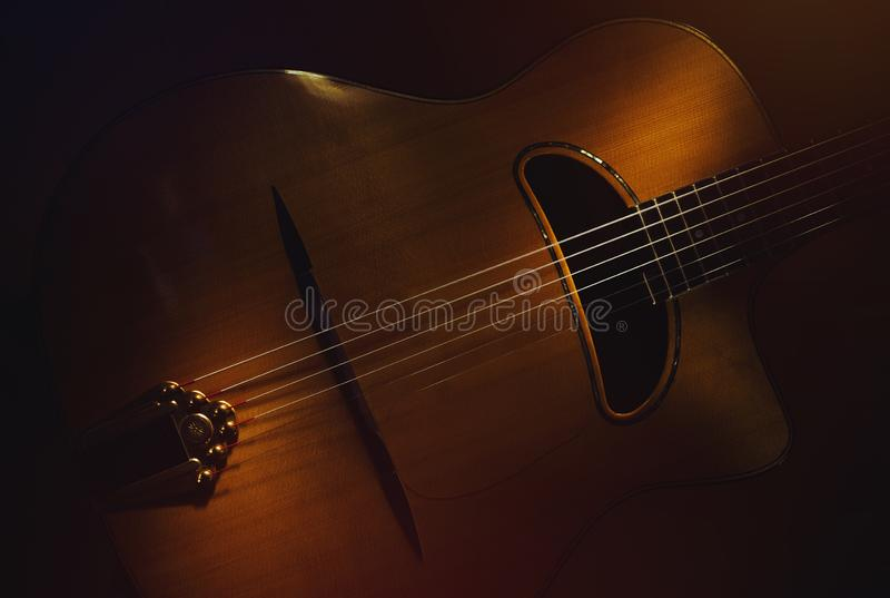 Old Gypsy Acoustic Guitar. Details of old retroacoustic guitar, gypsy jazz in style of Django stock images