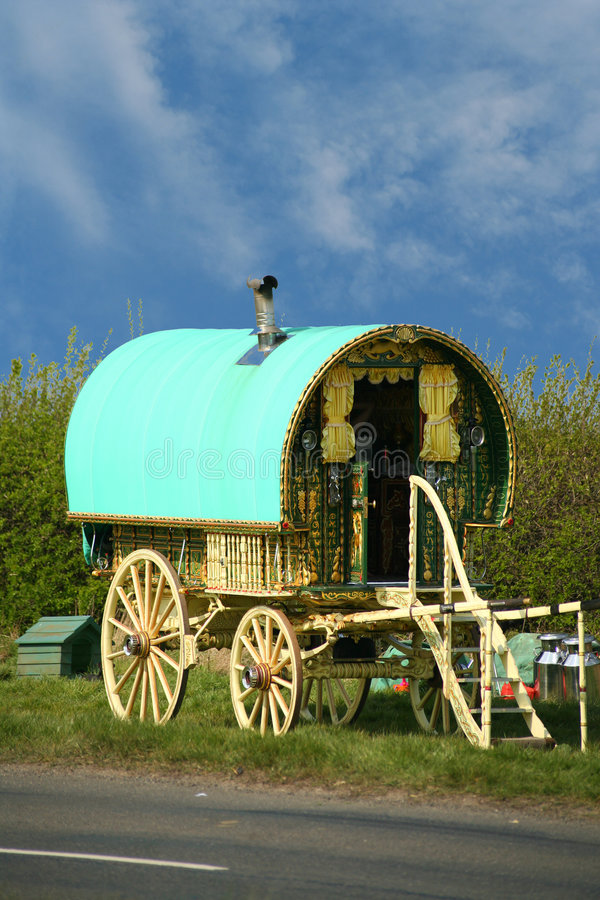 Old gypsy caravan. Old fashioned gypsy caravan parked on side of the road
