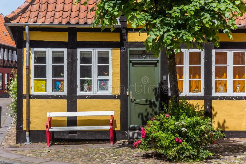 Old half timbered house with bench in Ribe royalty free stock image