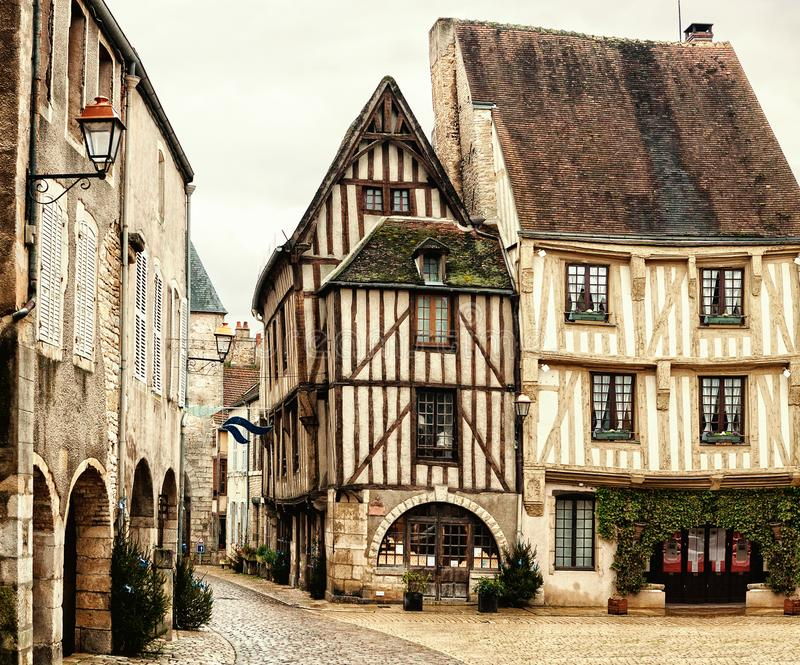 Old half-timbered houses on Town Hall Square of Noyers Noyers-sur-Serein.   Noyers is beautiful medieval French village  in Burg. Old half-timbered houses on stock photo