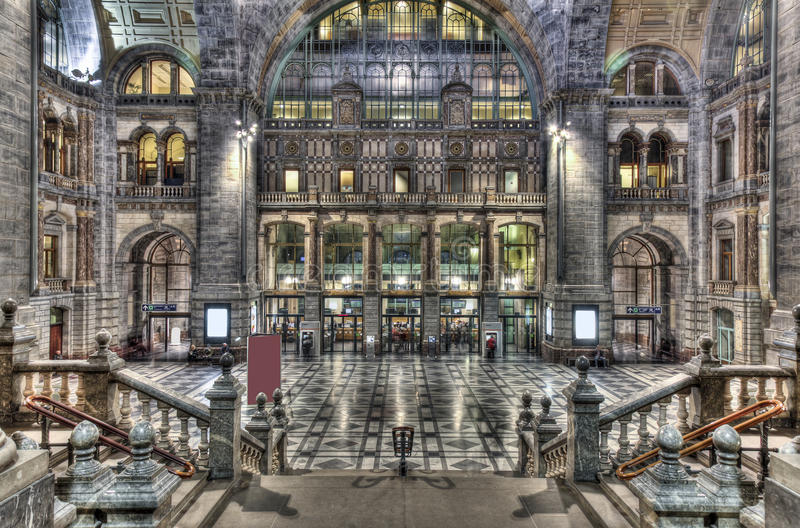 Old hall Train station. Symmetrical HDR composition of the main hall of the old part of the famous Antwerp Railway train station at night, also known as the stock photos