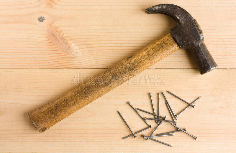 Old Hammer And Iron Nails On Wooden Floor Royalty Free Stock Photography