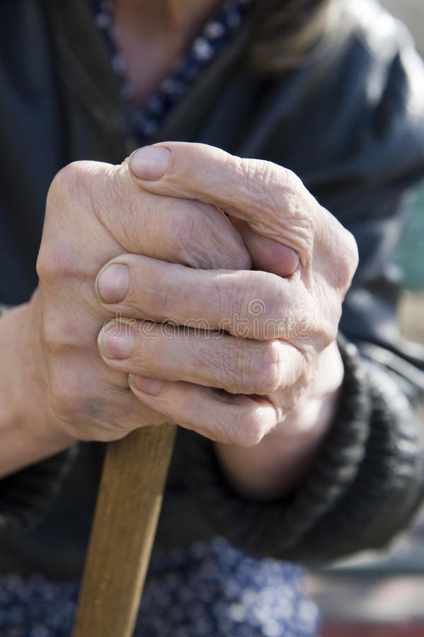 Old hand. S holding a cane stock image