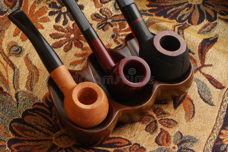 Old hand carved tobacco pipes royalty free stock image